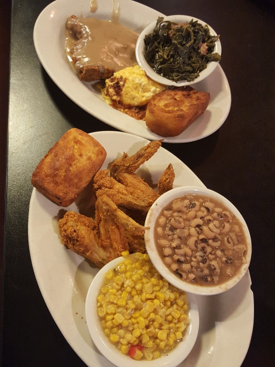 Smothered Pork Chops, Macaroni and Cheese, Collard Greens, Fried Chicken, Corn, and black eyed peas